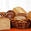 Full basket of healthy whole grain breads — Stock Photo