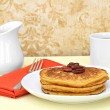 Pumpkin pancakes, pecans, and coffee. — Stock Photo