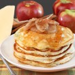 Stacked pancakes with baked apples topping. - Stock Photo