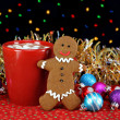 Cocoa and a gingerbread cookie in night setting with Christmas l - Stock Photo