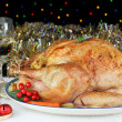 Whole Roasted, Stuffed Turkey in an Evening Christmas Setting - Stock Photo