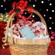 Christmas basket of cranberry bar cookies in front of colorful b — Stock Photo