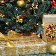 Silver and gold gifts under Christmas Tree — Stock Photo