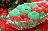 Christmas jelly candy in glass dish on doily. — Stock Photo