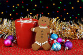 Cocoa and a gingerbread cookie in night setting with Christmas l — Stock Photo