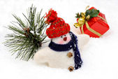 Wooly Snowman in Snow with Tree and Gift — Stock Photo
