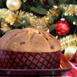 Whole Panettone in front of Christmas Tree — Stock Photo