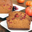 Pumpkin Cranberry Bread, sliced and whole. — Stock Photo