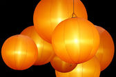 Warmly colored balloon lamps isolated on black background — Stock Photo