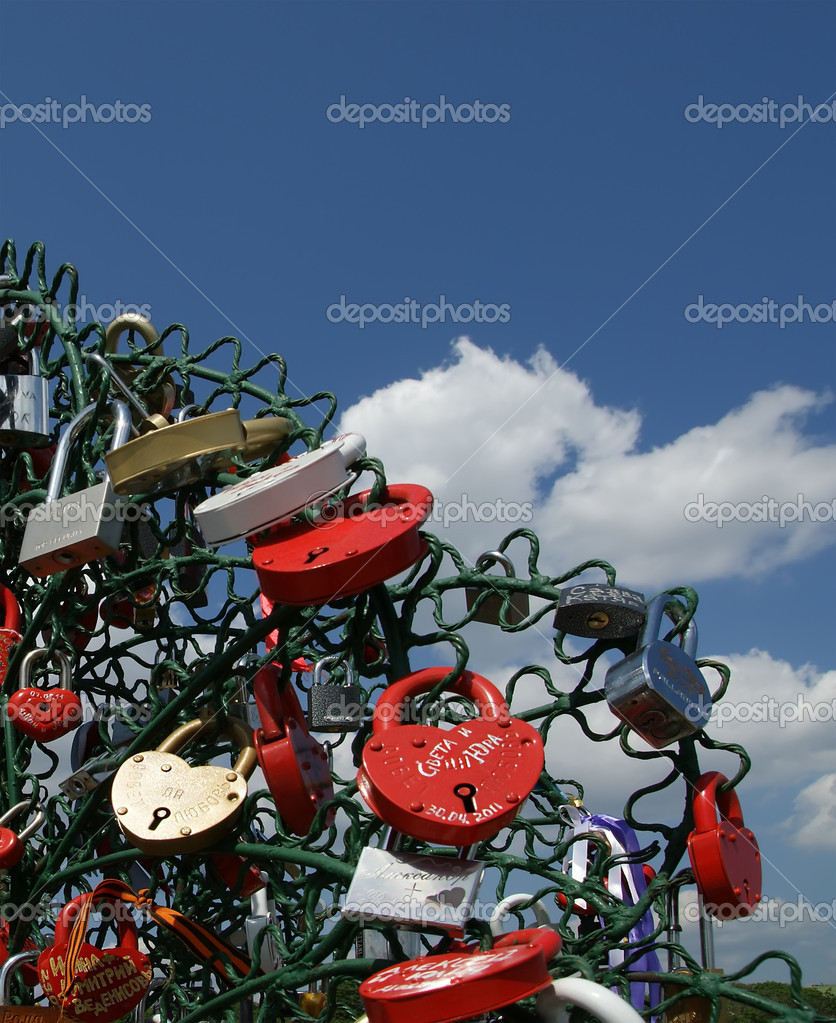 Padlocks in the shape of a heart - a symbol of eternal love and union — Stock Photo #6843145