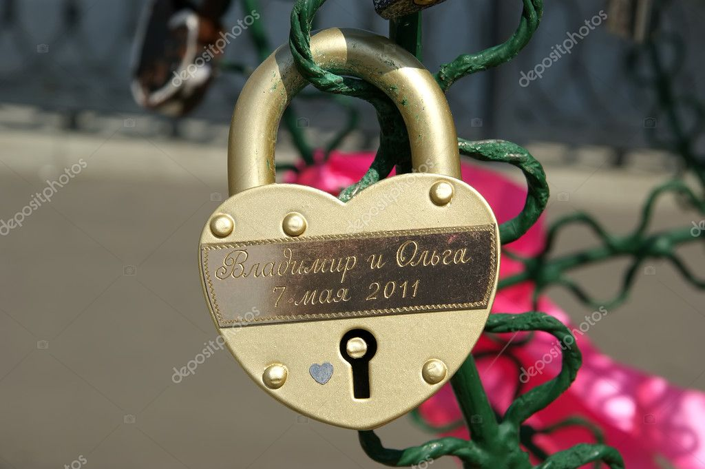 Padlocks in the shape of a heart - a symbol of eternal love and union — Stock Photo #6843544