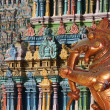 Traditional statues of gods and goddesses in the Hindu temple - Stock Photo