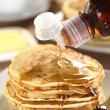 Stock Photo: Pouring Maple Syrup on Pancakes