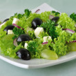 Salad of lettuce with cheese and grapes - Stockfoto