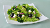 Salad of lettuce with cheese and grapes — Stock Photo