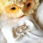 Elegant wedding rings on white pillow — Stock Photo #6933188
