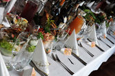 Table with food and drink — Stock Photo