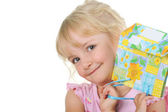 Little cute girl with present posing to camera — Stock Photo