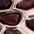 Chocolates in foil box - Stock Photo
