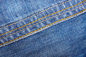 Blue jeans with yellow stitches — Stock Photo