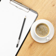 Clipboard and coffee — Stock Photo