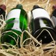 Wine bottles in straw — Stock Photo #7125207