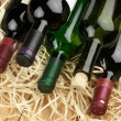 Wine bottles in straw — ストック写真