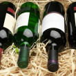 Wine bottles in straw — Foto de Stock