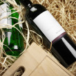 Wine bottles in straw - Stock Photo