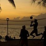 Beach volleyball, sunset on the beach — Stock Photo