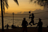 Beach volleyball, sunset on the beach — Stock Photo