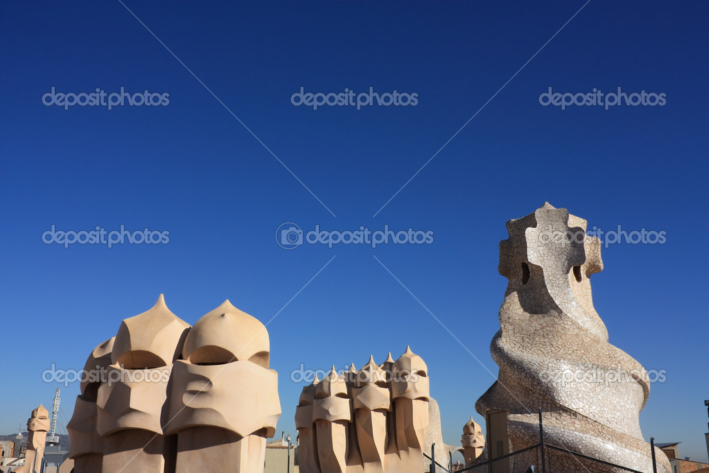 On the terrace of the Casa Mila (also called La Pedrera) is a cross-shaped chimneys and soldiers of anthropomorphic forms created by Antonio Gaudi. — Stock Photo #7308646