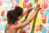 Girl playing with paint — Stock Photo