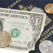 USD with assorted cpoins and CND (loonie) with clipping path — Stock Photo