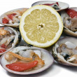 Smooth clams and lemon. — Stock Photo #7094523