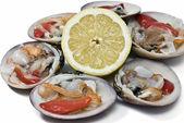 Smooth clams and lemon. — Stock Photo