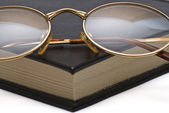 Glasses on the corner of the book. — Stock Photo