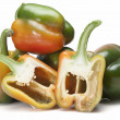 Fresh peppers and two halves. — Zdjęcie stockowe