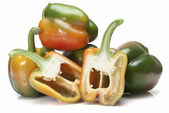 Fresh peppers and two halves. — Stock Photo