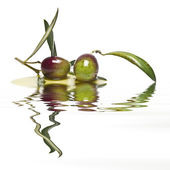 Olives reflected on water. — Stock Photo