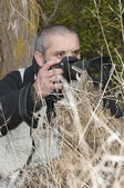 Photographer in a wild environment. — Stock Photo