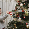 Stock Photo: Decorating the Christmas tree.