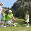 Stock Photo: Family Golf Lesson