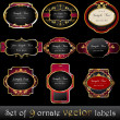 Set of elegant, dark, gold-framed labels — Imagen vectorial