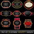 Set of elegant, dark, gold-framed labels — Stockvectorbeeld