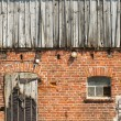 Royalty-Free Stock Photo: Old window on red brick wall