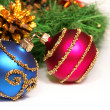 Royalty-Free Stock Photo: Nice Xmas decorations (red and blue spheres, golden cone and Xmas tree brunch) over white