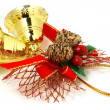 Royalty-Free Stock Photo: Nice golden Xmas bells with red ribbon isolated over white
