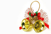 Nice golden Xmas bells with red ribbon isolated over white — Stock Photo