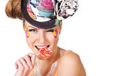 Girl with face-art holding lollipop — Stock Photo
